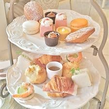 Small afternoon tea treats served on an ornate 2 tier tray.