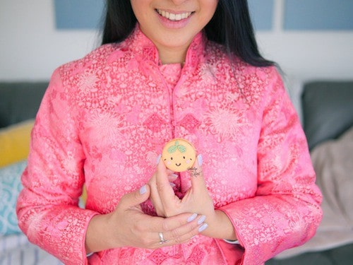 "Me in a several decade old Cheongsam belonging to my Auntie. She told me that she wore this on her wedding day when she was still as ""thin"" as I am now. I put it on this year and found that I'm almost unable to button it up fully. Too many macarons?........."