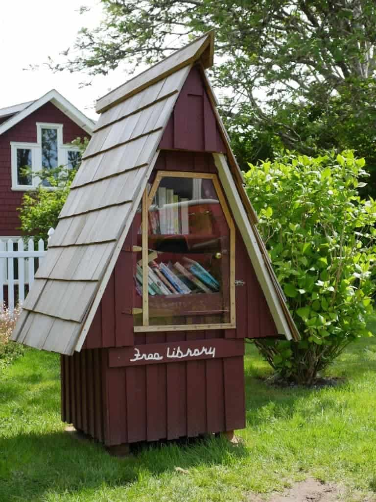 Life is quaint when you can get books from this adorable Free Library outside of a church in town.