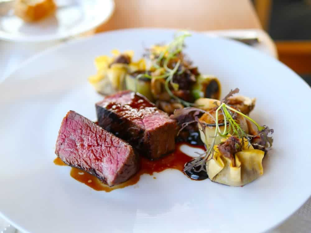 A la carte from The Pointe Dinner menu. Quist Farm Beef Steak with Short Rib Dumpling, caramelized soy and walnuts.