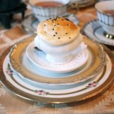 A small souffle soup on stacks of vintage tea saucers.