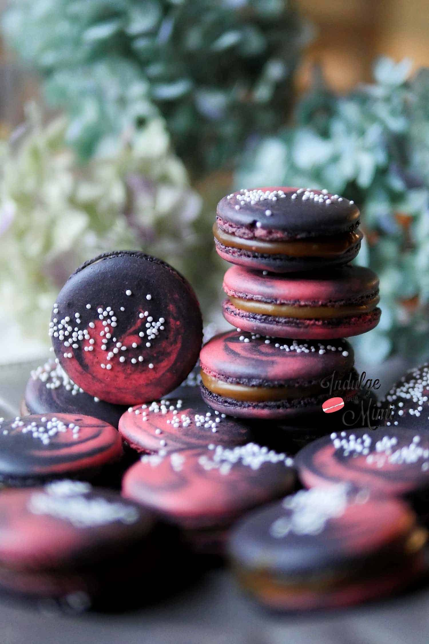 A stack of galaxy macarons standing tall.