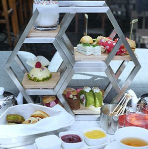 Afternoon tea set served on a unique Hexagonal display.