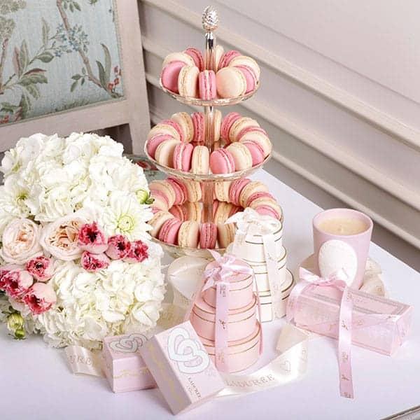 Laduree wedding favors on a table.