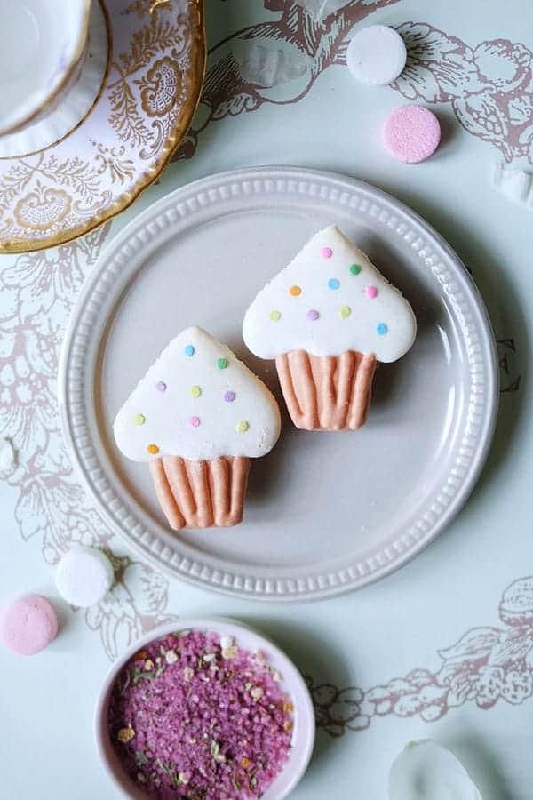 Cupcake macarons on a plate.