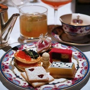 Themed afternoon tea set featuring treats that look like board game pieces.