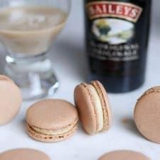 baileys irish cream macarons with some liqueur in a cup in the back.