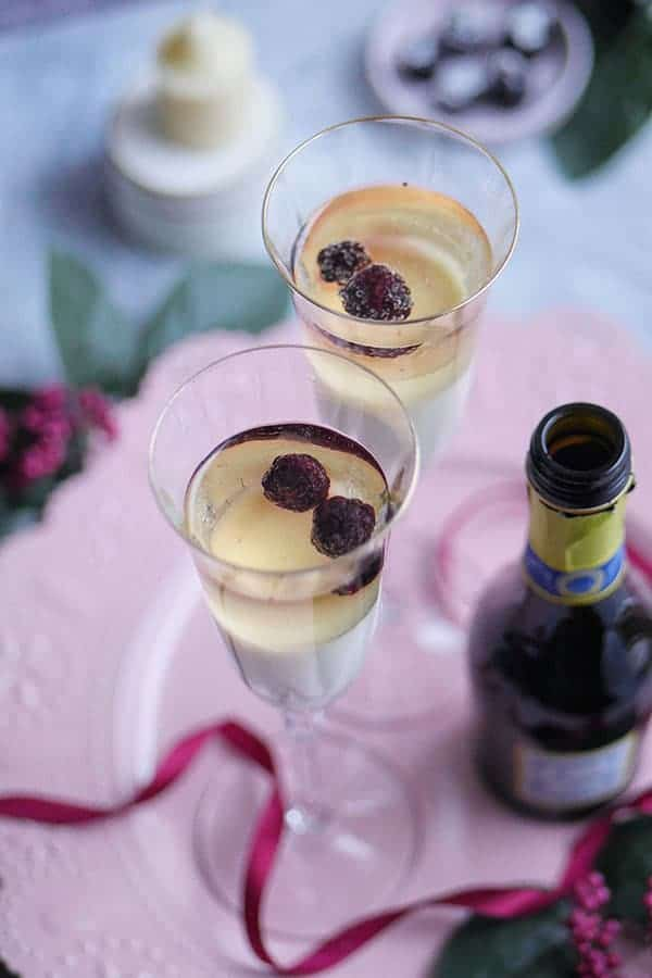 top view of tall flute glasses filled with champagne panna cotta.