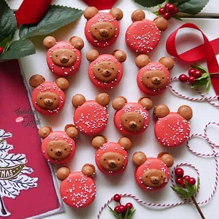Christmas bear macarons on a table with a Christmas card.