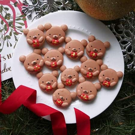 Christmas bear macarons holding presents.