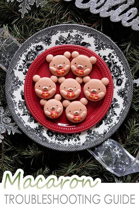 7 Christmas bear macarons holding onto present boxes.