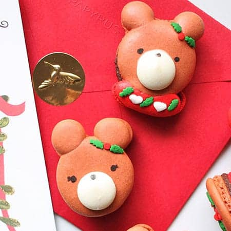 Bear macarons in ugly Christmas sweaters.