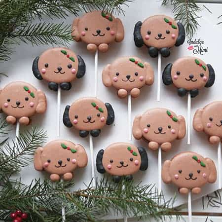 Christmas dog macarons on a lollipop stick.