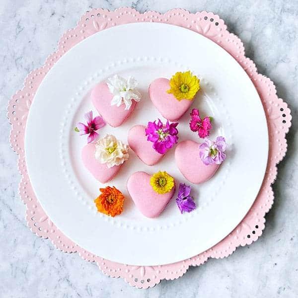 Heart macarons on a plate.