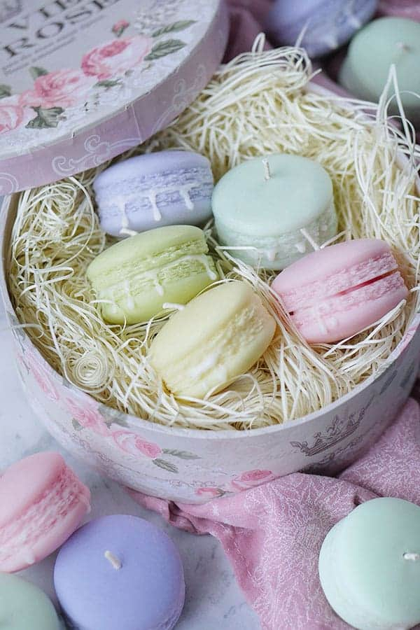 Macaron candles inside a gift box.