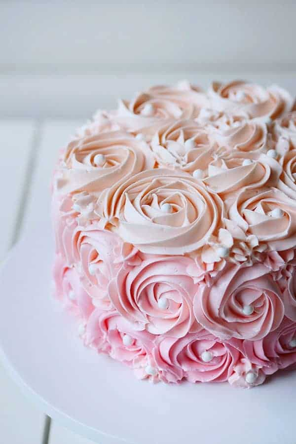 Close up of floral buttercream cake.