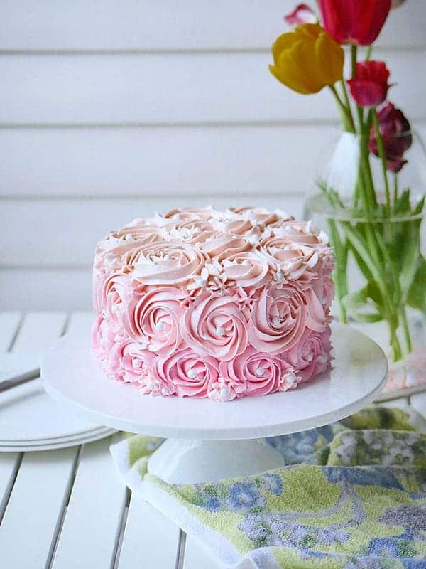 Swiss buttercream piped onto a cake in rossette pattern.