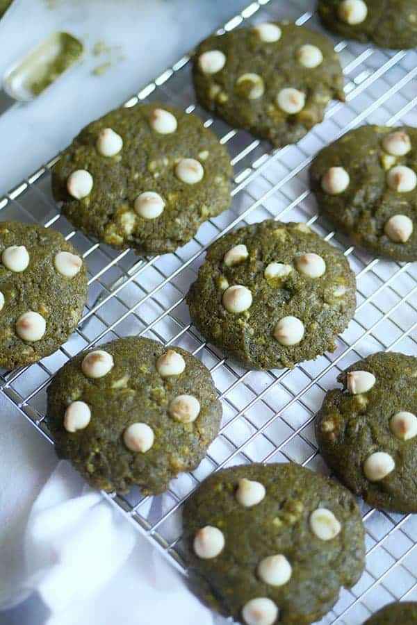 Close up of slightly browned white chocolate on top of matcha cookies.