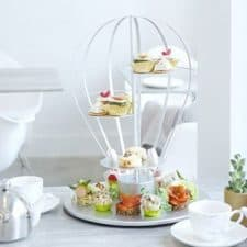 Afternoon tea served on a tea display resembling a parachute.