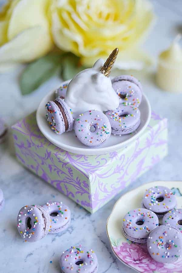 Unicorn plate with some lavender macarons on it.