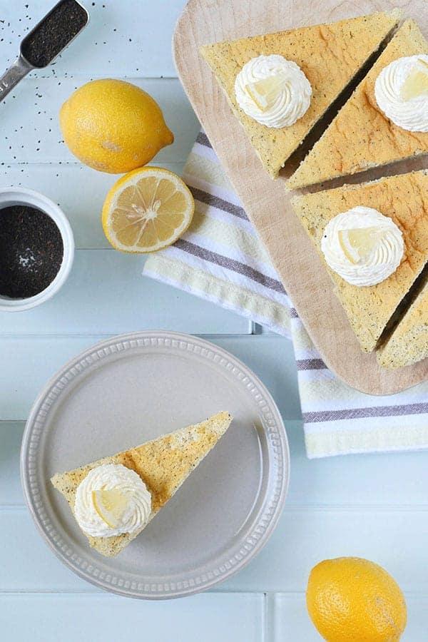 Lemon cheesecake shown with lemons and earl grey tea leaves.