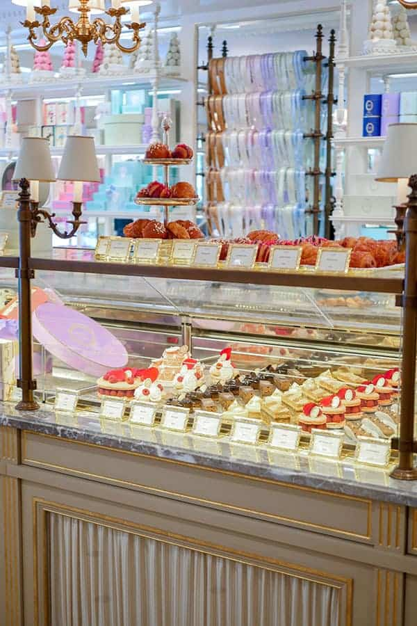 Inside Laduree shop with dessert counter.