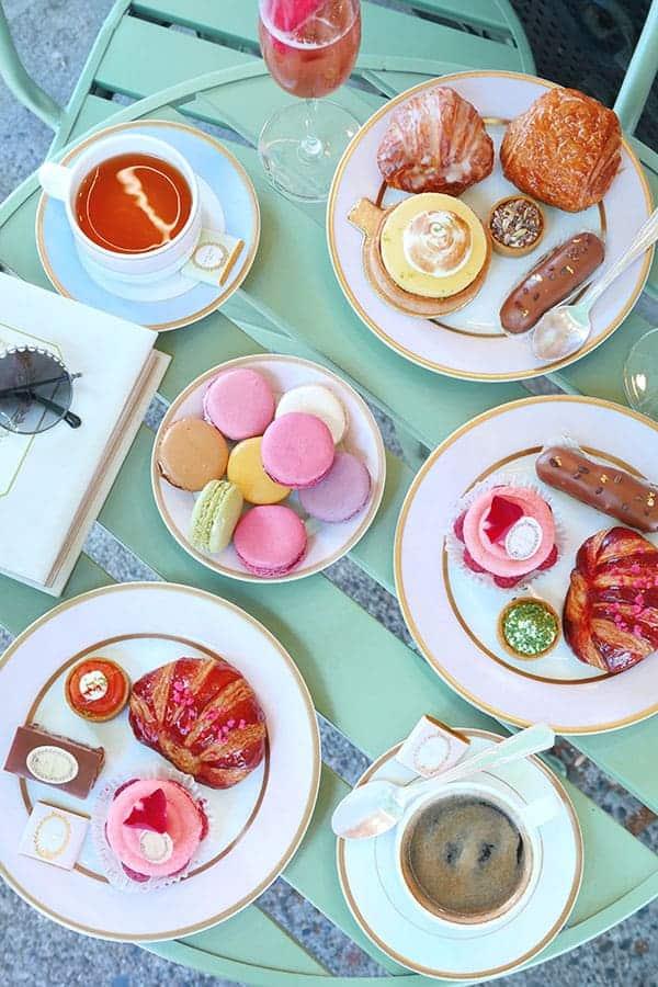 overhead shot of Laduree desserts on a picnic table.