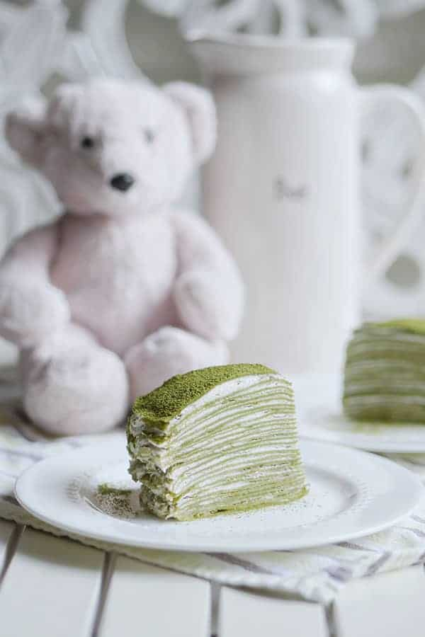 A cross section slice of matcha mille crepe that shows all 28 layers of crepes in the cake.