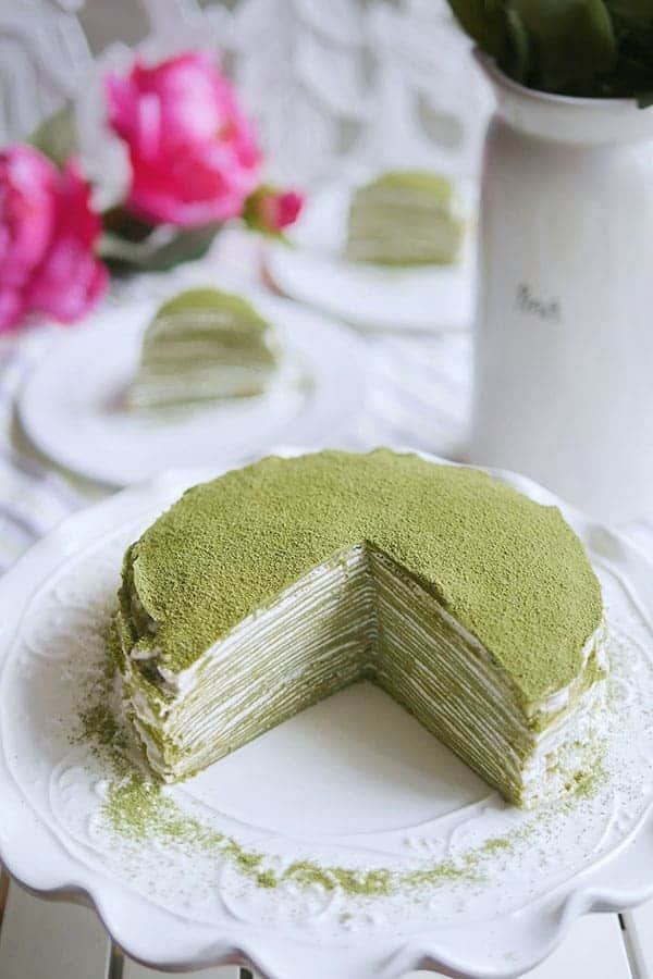 Matcha powder dusted on top of the 28 layer mille crepe cake.