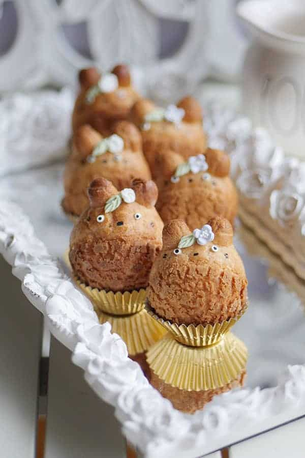Japanese Totoro character cream puffs on a mirror tray.
