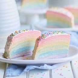 Ultra thin crepes in different colors layered in a rainbow pattern.