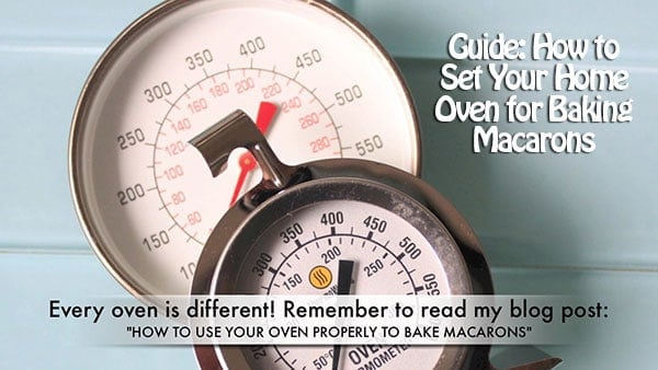 2 oven thermometers are set on a kitchen counter.