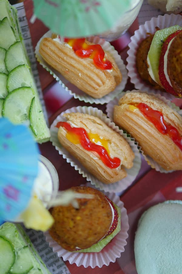 Eclairs made into hotdog shapes.