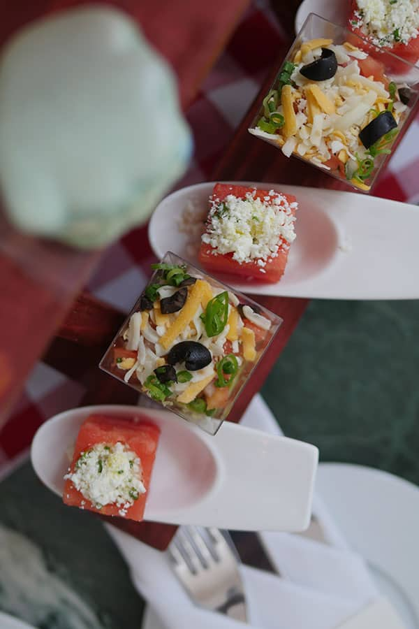 Watermelon cube with goat cheese.
