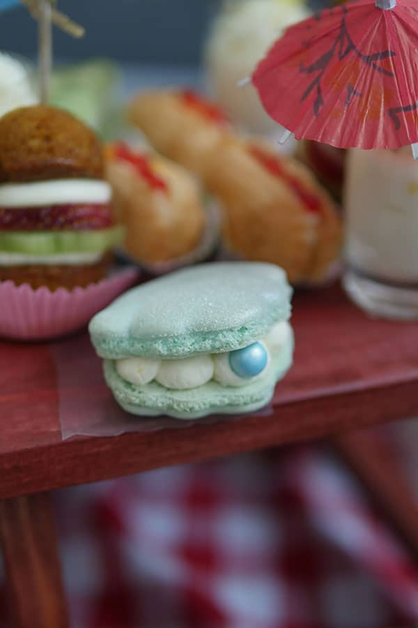 A seashell macaron with a pearl sprinkle.