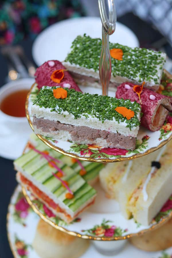 Finger sandwiches on a tea tray side view.