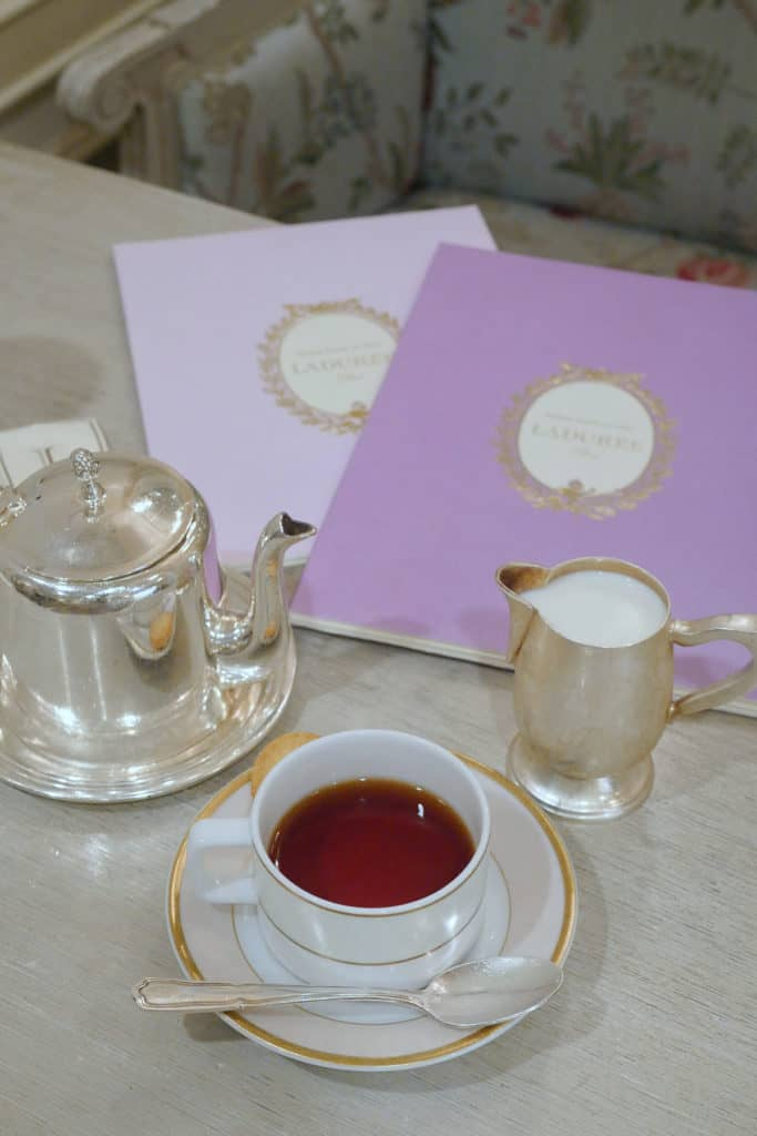 Tea cups and menus on a table.