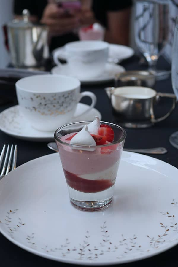 Amuse bouche strawberry mousse served in a shot glass.