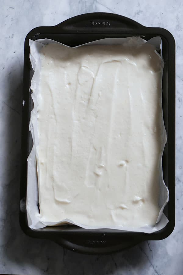 Mixed swiss cake roll batter in a cake pan.