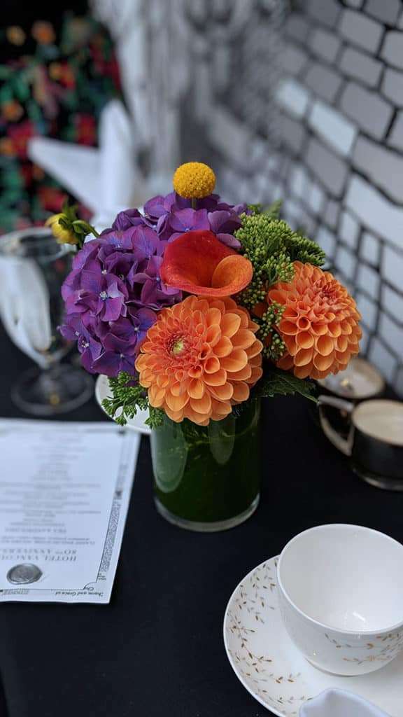 Flower bouquet on the table with a menu.