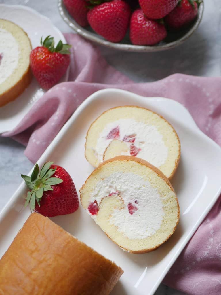 Fresh strawberry and cream Japanese swiss cake roll. Strawberries and cream rolled inside a vanilla cake base.