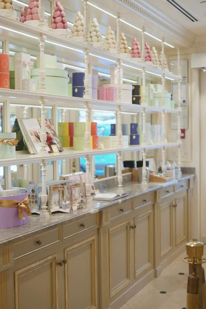 Gifts lined up on shelves at Laduree.