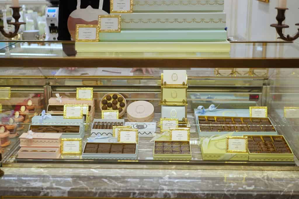 Laduree chocolates displayed in gift boxes.