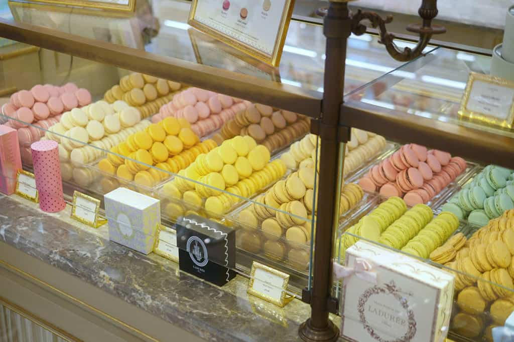 Piles of macarons inside a display case.