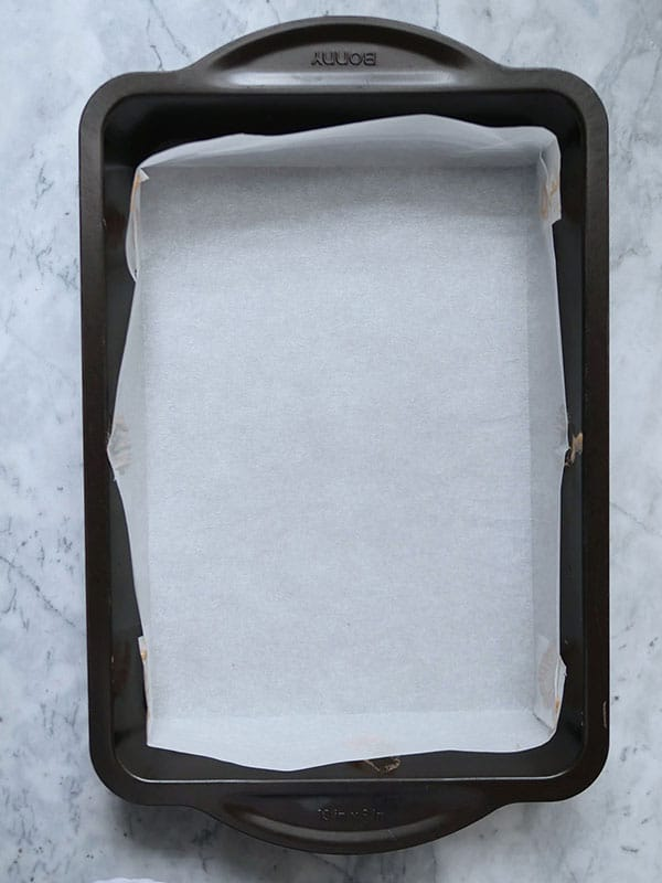 Parchment paper in an empty cake pan.