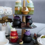 Harry Potter inspired afternoon tea treats on a 3-tier display.