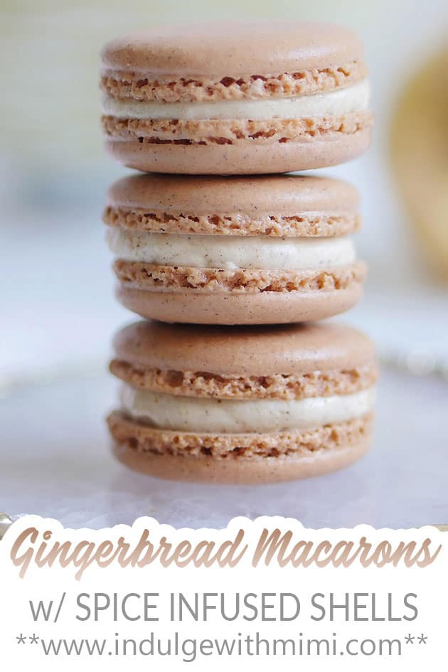 A stack of 3 gingerbread spice macarons on a plate.