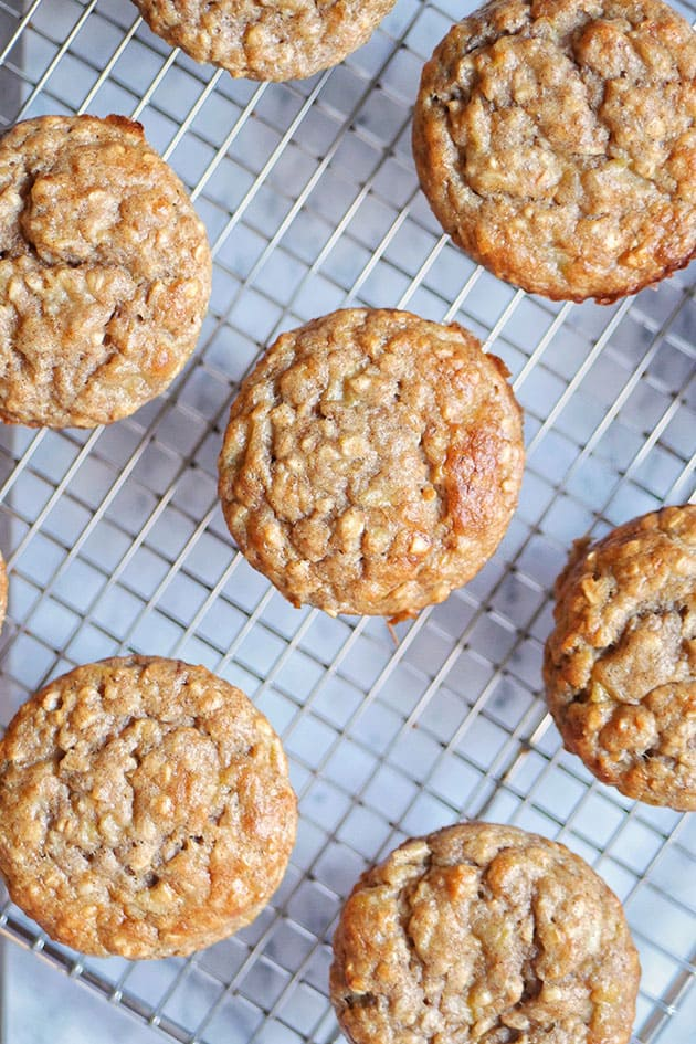 Close up of Einkorn oat banana muffins cooling on a rack.