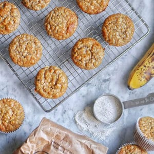 banana oat muffins cooling on a rack.