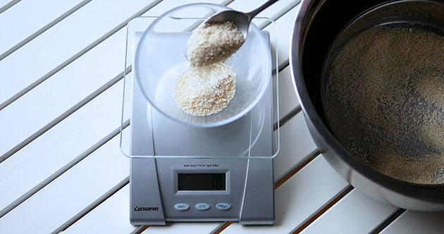 Weighing almond flour with a scale.